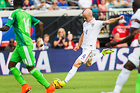 June 07, 2014:   the United States of America midfielder Michael Bradley (4) takes a shot on the goal during first half action between the USA Men's National Soccer team and Nigeria at EverBank Field in Jacksonville, Florida.  This is the last match before the USA team leaves for Brazil and the 2014 World Cup Championships. USA defeated Nigeria 2-1.
