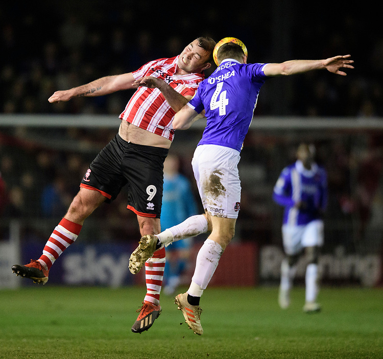 Lincoln City's Matt Rhead vies for possession with Exeter City's Dara O'Shea<br /> <br /> Photographer Chris Vaughan/CameraSport<br /> <br /> The EFL Sky Bet League Two - Lincoln City v Exeter City - Tuesday 26th February 2019 - Sincil Bank - Lincoln<br /> <br /> World Copyright © 2019 CameraSport. All rights reserved. 43 Linden Ave. Countesthorpe. Leicester. England. LE8 5PG - Tel: +44 (0) 116 277 4147 - admin@camerasport.com - www.camerasport.com
