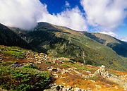 Tuckerman Ravine and Mount Washington engulfed in cloud cover from Boott Spur Trail in Sargent's Purchase in the New Hampshire White Mountains; this area is part of the Presidential Range. Tuckerman Ravine is named for Professor Edward Tuckerman, a botanist and early explorer of the White Mountains.