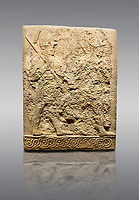 Picture &amp; image of Hittite sculpted orthostats panels of Long Wall Limestone, Karkamıs, (Kargamıs), Carchemish (Karkemish), 900-700 B.C. Soldiers. Anatolian Civilisations Museum, Ankara, Turkey<br /> <br /> Figure of two helmeted warriors. They have their shield in their back and their spear in their hand. The prisoner in their front is depicted as small. The lower part of the orthostat is decorated with braiding motifs. <br /> <br /> On a gray background.