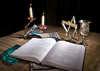 STAFF PHOTO ILLUSTRATION BEN GOFF  @NWABenGoff -- 12/04/14 An arrangement of a prayer book, menorah, prayer candles, and other common artifacts of the Jewish faith at Waterway Christian Church in Cave Springs, where Congregation Etz Chaim holds services, on Thursday Dec. 4, 2014.