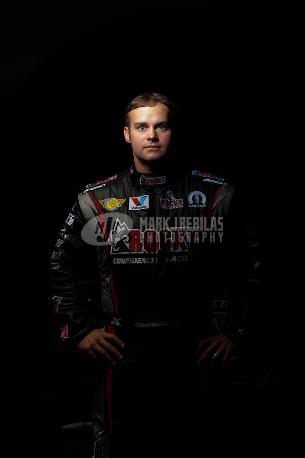 Dec. 5, 2012; Brownsburg, IN, USA; NHRA funny car driver Matt Hagan poses for a portrait during a photo shoot at the Don Schumacher Racing shop.  Mandatory Credit: Mark J. Rebilas-