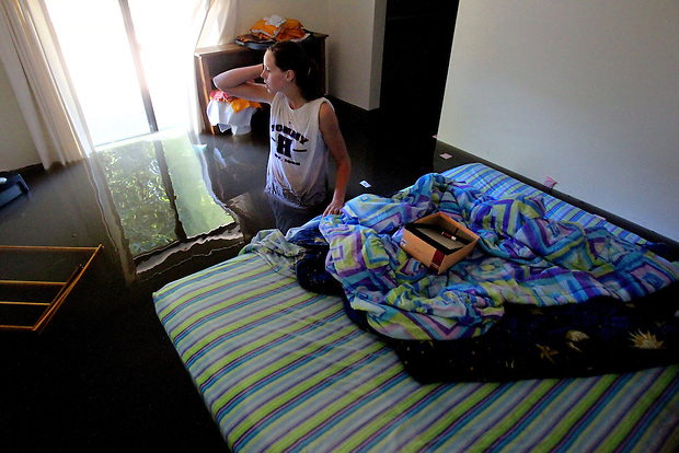 Laura Eggers pauses by her floating bed in her flooded bedroom while salvaging some of her belongings from her apartment on South 5th St. in Ames, Iowa on Wednesday, August 11, 2010.
