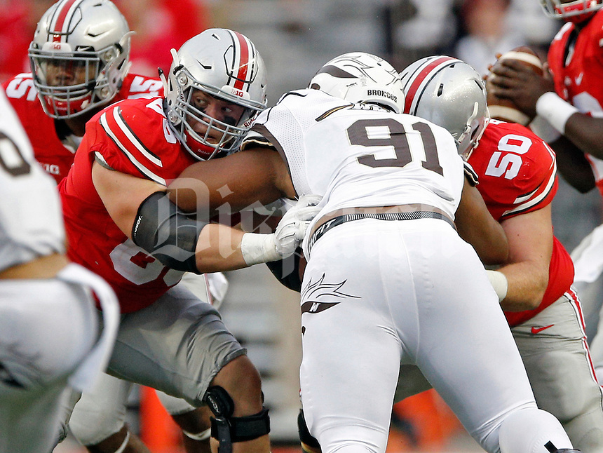 Ohio State Buckeyes offensive lineman Pat Elflein (65) and Ohio State Buckeyes offensive lineman Jacoby Boren (50) against Western Michigan Broncos in their game at Ohio Stadium on September 26, 2015.  (Dispatch photo by Kyle Robertson)
