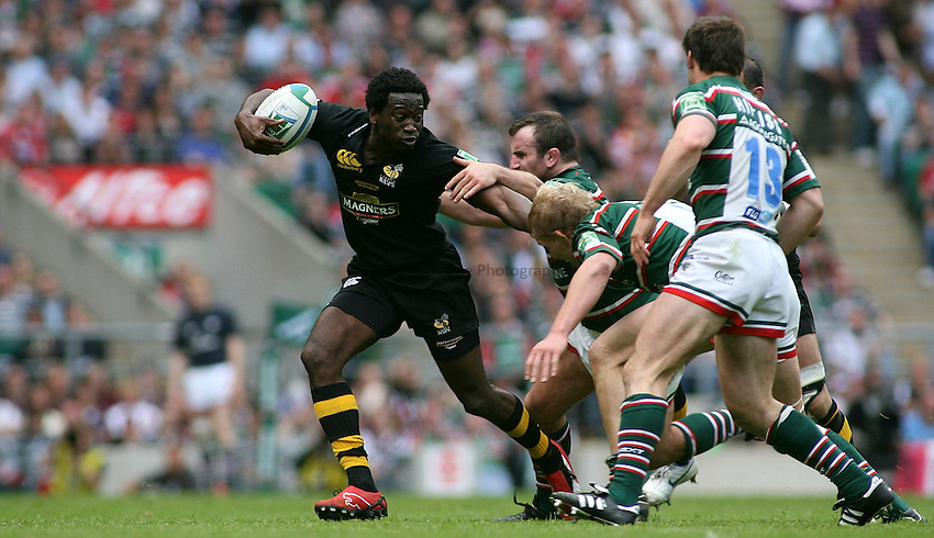 Photo: Paul Thomas..London Wasps v Leicester Tigers. Heineken Cup Final. 20/05/2007...Paul Sackey (L) of Wasps tries to evade the Leicester cover defence.
