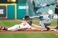 Kentucky Wildcats first baseman Kole Cottam (13) waits for a pick-off throw as Grayson Padgett (18) of the Houston Cougars dives back towards first base in game two of the 2018 Shriners Hospitals for Children College Classic at Minute Maid Park on March 2, 2018 in Houston, Texas.  The Wildcats defeated the Cougars 14-2 in 7 innings.   (Brian Westerholt/Four Seam Images)