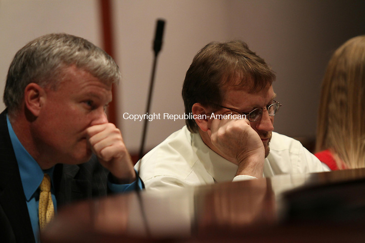 HARTFORD, CT - 12 August, 2011 - 081211MO03 - Winsted Town Manager Dale L. Martin, left, and Selectman Glenn S. Albanesius listen Friday as Winsted school officials explain the plan to complete a long-overdue audit, the absence of which has left the town unable to borrow money. The audit of 2009-10 finances was due in December. Jim Moore Republican-American.