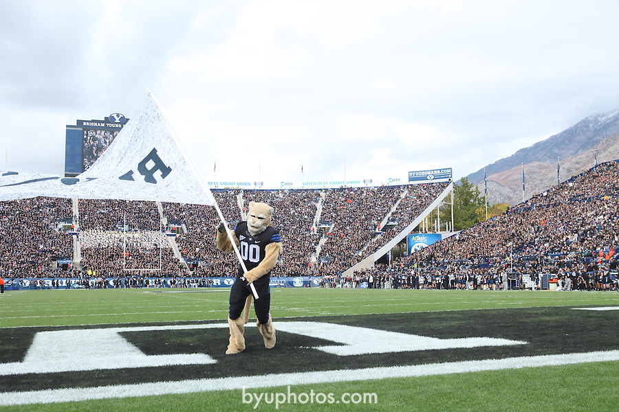 12FTB vs Oregon State 1564.CR2<br /> <br /> 12FTB vs Oregon State, Cosmo the Cougar holding Flag, Blackout Uniform, Football Field, LVES LaVell Edwards Stadium.<br /> <br /> BYU-24<br /> Oregon St-42<br /> <br /> October 13, 2012<br /> <br /> Photo by Marcos Escalona/BYU<br /> <br /> &copy; BYU PHOTO 2012<br /> All Rights Reserved<br /> photo@byu.edu  (801)422-7322