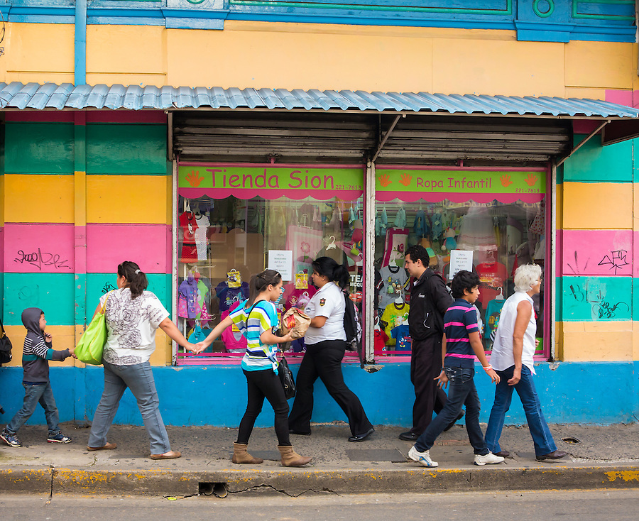 SAN JOSE, COSTA RICA - CIRCA AUGUST 2012: Typical street scene with locals, circa 2012 in San Jose, a very popular tourist destination with 2.2 million foreign visitors a year.