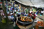 Cyclone Nargis survivors eat at a temple turned into a makeshift refugee center in the town of Labutta, in Irrawaddy Division, May 10, 2008. Despairing survivors in Myanmar awaited emergency relief on Friday, a week after 100,000 people were feared killed as the cyclone roared across the farms and villages of the low-lying Irrawaddy delta region. The storm is the most devastating one to hit Asia since 1991, when 143,000 people were killed in neighboring Bangladesh. Photo by Eyal Warshavsky  *** Local Caption *** ëì äæëåéåú ùîåøåú ìàéì åøùáñ÷é àéï ìòùåú áúîåðåú ùéîåù ììà àéùåø