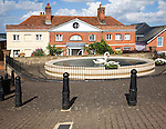 Swan basin pond and historic buildings, Mistley, Essex, England