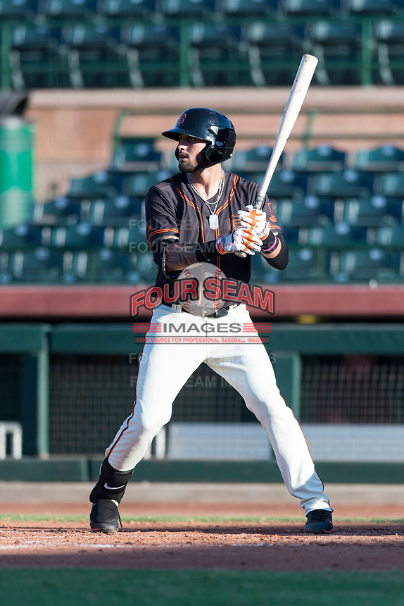 AZL Giants Orange first baseman Frankie Tostado (10) at bat during an Arizona League game against the AZL Rangers at Scottsdale Stadium on August 4, 2018 in Scottsdale, Arizona. The AZL Giants Black defeated the AZL Rangers by a score of 3-2 in the first game of a doubleheader. (Zachary Lucy/Four Seam Images)