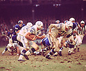 Baltimore Colts Dan Sullivan (71) lead blocks for Jerry Hill (45) during a game agains the New York Giants on November 3,1968 at Yankee Stadium in the Bronx, New York.  The  Baltimore Colts beat the New York Giants 26-0.  John Williams played for 12 years, with 2 different teams.(SportPics)