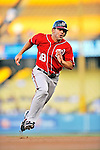 23 July 2011: Washington Nationals infielder Danny Espinosa hustles to third during a game against the Los Angeles Dodgers at Dodger Stadium in Los Angeles, California. The Dodgers rallied to defeat the Nationals 7-6 on a Rafael Furcal walk-off, RBI double in the bottom of the 9th inning. Mandatory Credit: Ed Wolfstein Photo