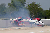 Apr. 26, 2013; Baytown, TX, USA: NHRA comp eliminator driver Mike Trumble loses control and crashes during qualifying for the Spring Nationals at Royal Purple Raceway. Trumble was uninjured. Mandatory Credit: Mark J. Rebilas-