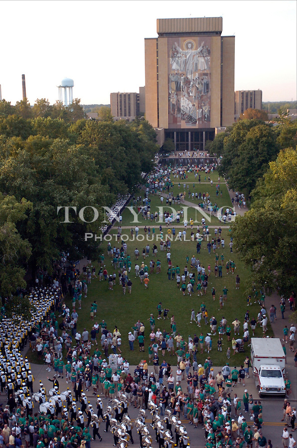 "The Michigan and Irish marching bands promenade out of the stadium and around ""Touchdown Jesus"" afte the Wolverines' 28-20 loss to Notre Dame on Saturday, September 11, 2004 at Notre Dame Stadium in South Bend, Indiana. (Photo by TONY DING/Daily)."
