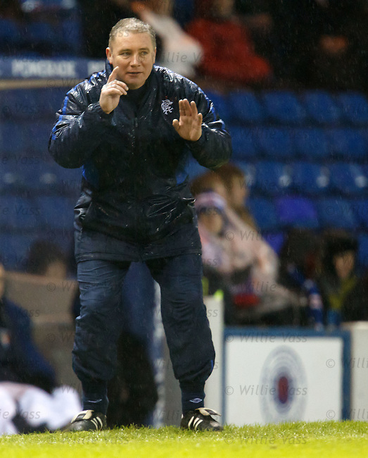 A rain sodden Ally McCoist about to make a pertinent point to his players