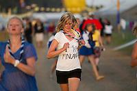 Finish girl running. Photo: Magnus Fröderberg/Scouterna