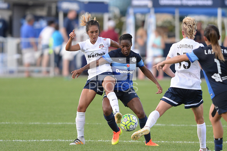 Kansas City, MO - Saturday July 16, 2016: Caprice Dydasco, Tiffany McCarty during a regular season National Women's Soccer League (NWSL) match between FC Kansas City and the Washington Spirit at Swope Soccer Village.