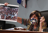 United States Representative Rosa DeLauro (Democrat of Connecticut) ,chairwoman of the US House Appropriations Subcommittee on Labor, Health and Human Services, Education, and Related Agencies, holds a photograph from the Lake of the Ozarks in Missouri on Memorial Day Weekend, during a hearing on Capitol Hill in Washington, DC on Thursday, June 4, 2020.  <br /> Credit: Tasos Katopodis / Pool via CNP/AdMedia
