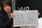 "January 16, 2019, Tokyo, Japan - Japanese EMS company VAIO employee displays a dual pages electronic music score ""GVIDO"" with e-paper display which can be written in by a stylus like conventional papers at an robot exhibition Robodex in Tokyo on Wednesday, January 16, 2019. Some 220 robot companies display their recent products and technlogies at a three-day exhibition.   (Photo by Yoshio Tsunoda/AFLO)"