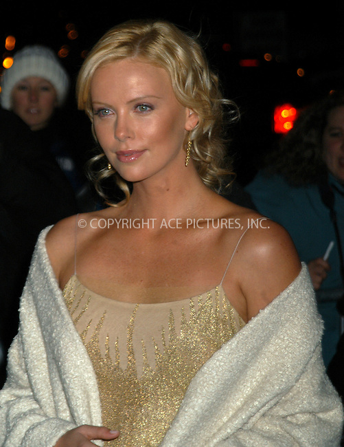Actress Charlize Theron arrives at the 2003 National Review Board Awards Gala at the 'Tavern on the Green', New York City. January 13 2004. Please byline: AJ SOKALNER/NY Photo Press.   ..*PAY-PER-USE*      ....NY Photo Press:  ..phone (646) 267-6913;   ..e-mail: info@nyphotopress.com