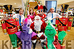 Launching the CH Chemist Santa Parade in the store on Monday evening. Front l to r: Emily Fitzgerald (Twlight Sparkle), Santa Claus and Ellie Ford (Grinch). Back l to r: Peter Harty (CH Chemist), Laura Lee Curtin (Fairy Twinkle), Joan Keating (Minnie Mouse) and Kevin Riardon (CH Chemist)