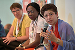 """Azza Karam, senior advisor to the United Nations Population Fund, speaks during a July 22 session of """"Faith Building Bridges"""" in Amsterdam, the Netherlands. The July 21-22 interfaith event, sponsored by the World Council of Churches-Ecumenical Advocacy Alliance, was held on the eve of the 2018 International AIDS Conference."""