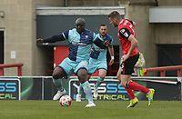 Adebayo Akinfenwa (L) of Wycombe Wanderers challenges for the ball against Ryan Edwards (R) of Morecambe during the Sky Bet League 2 match between Morecambe and Wycombe Wanderers at the Globe Arena, Morecambe, England on 29 April 2017. Photo by Stephen Gaunt / PRiME Media Images.