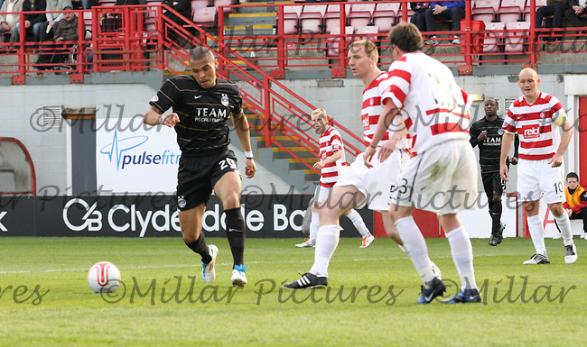 Josh Magennis tries to intercept the pass from Andy Graham