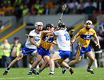 David Reidy of Clare is tackled by Jake Dillon and Ian Kenny of Waterford watched by Conor Mc Grath of Clare  during their Munster  championship round robin game at Cusack Park Photograph by John Kelly.