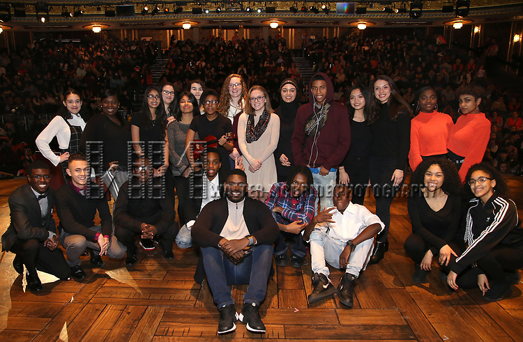 """Carvens Lissaint with student performers during The Rockefeller Foundation and The Gilder Lehrman Institute of American History sponsored High School student #eduHam matinee performance of """"Hamilton"""" Q & A at the Richard Rodgers Theatre on December 5,, 2018 in New York City."""