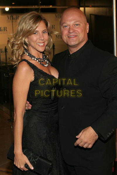 MICHAEL CHIKLIS & GUEST.The Museum of Television & Radio Honors Peter Chernin and John Wells At its Annual Los Angeles Gala held at the Beverly Hilton Hotel, Beverly Hills, California.  .November 7th, 2005.Photo: Zach Lipp/AdMedia/Capital Pictures.Ref: Zl/ADM.half length arm around waist black.www.capitalpictures.com.sales@capitalpictures.com.© Capital Pictures.