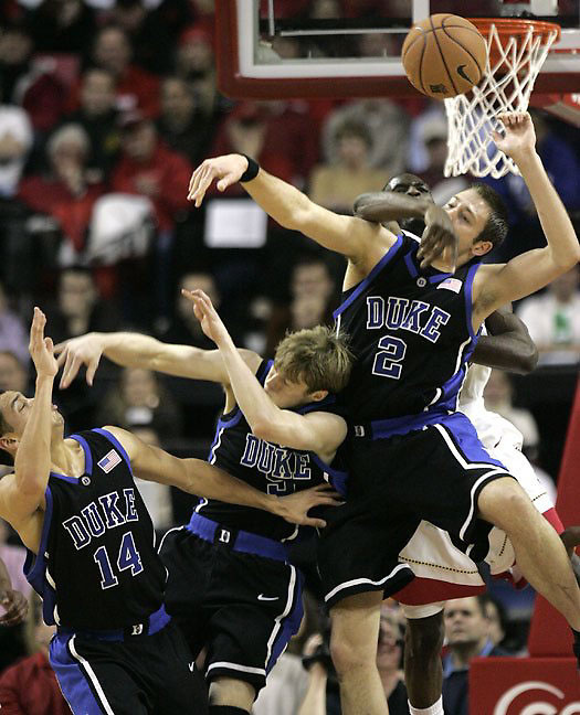 Duke's Josh McRoberts (2) collides with Maryland's Ekene Ibekwe (background) on a rebound attempt near Duke's David McClure (14) and Martynas Pocius (second from left) during the first half of Maryland's win at Comcast Center in College Park, MD, on Sunday, Feb. 11, 2007.