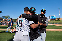 Salt River Rafters pitcher Miguel Aguilar (31), of the Arizona Diamondbacks organization, celebrates with coach Luis Ramirez (19) after winning the Arizona Fall League Championship Game against the Surprise Saguaros on October 26, 2019 at Salt River Fields at Talking Stick in Scottsdale, Arizona. The Rafters defeated the Saguaros 5-1. (Zachary Lucy/Four Seam Images)