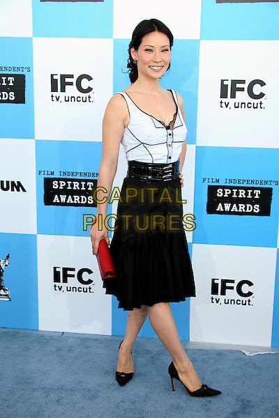 LUCY LIU.2007 Film Independent's Spirit Awards at the Santa Monica Pier, Santa Monica, California, USA,.24 February 2007..Full length black skirt belt waist white vest top.CAP/ADM/BP.©Byron Purvis/AdMedia/Capital Pictures.