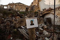 Onna, a few Kilometres from L'Aquila, is a village that was almost completely erased by the earthquake of April 6, 2009.  85% of its old buildings went destroyed, killing 40. <br /> Thanks to the initiative &quot;Come era bella Onna&quot; (&quot;How beautiful Onna was&quot;) a path has been setup. It unfolds through the rubble of the houses that collapsed. On the occasion of the commemoration of the 6th anniversary of the earthquake, relatives of the victims hanged portraits in front of what remains of their respective houses.  Onna, Italy. April 10, 2015