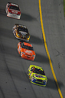Feb 10, 2007; Daytona, FL, USA; Nascar Nextel Cup driver Kyle Busch (5) leads Tony Stewart (20) Kurt Busch (2) and Elliott Sadler (19) during the Budweiser Shootout at Daytona International Speedway. Mandatory Credit: Mark J. Rebilas