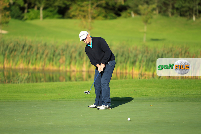 Michael Collins (Mallow Golf Range) on the 12th green during Round 1 of The Cassidy Golf 103rd Irish PGA Championship in Roganstown Golf Club on Thursday 10th October 2013.<br /> Picture:  Thos Caffrey / www.golffile.ie