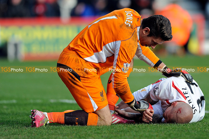 Martin Skirtel of Liverpool liesinjured attended by Brad Jones of Liverpool - AFC Bournemouth vs Liverpool - FA Cup 4th Round Football at the Goldsands Stadium, Bournemouth, Dorset - 25/01/14 - MANDATORY CREDIT: Denis Murphy/TGSPHOTO - Self billing applies where appropriate - 0845 094 6026 - contact@tgsphoto.co.uk - NO UNPAID USE