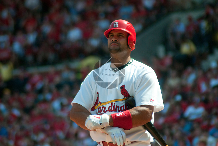 April 3,  2011                          St. Louis Cardinals first baseman Albert Pujols (5) adjusts his gloves. The St. Louis Cardinals defeated the San Diego Padres 2-0 in the final game of a three-game series on Sunday April 3, 2011 at Busch Stadium in downtown St. Louis.