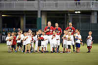 Fort Myers Miracle outfielders Marcus Knecht (9), Zach Granite (1) and Jason Kanzler (8) with baseball campers on the field before a game against the Daytona Tortugas on June 18, 2015 at Hammond Stadium in Fort Myers, Florida.  Fort Myers defeated Daytona 4-1.  (Mike Janes/Four Seam Images)