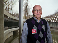 NWA Democrat-Gazette/BEN GOFF -- 02/23/15 Gary Martineck of Bella Vista poses for a photo during his shift volunteering at Crystal Bridges Museum of American Art in Bentonville on Monday Feb. 23, 2014.