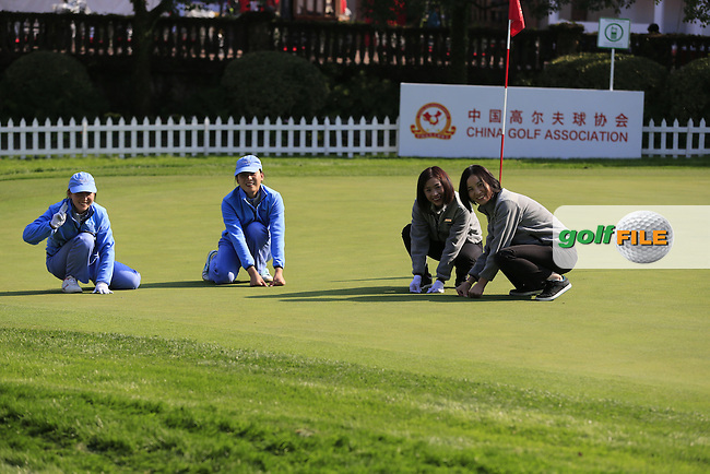 Green staff at work during Tuesday's Practice day of the WGC - HSBC Champions 2014 held at Sheshan International Golf Club, Shanghai, China. 4th November 2014.<br /> Picture: Eoin Clarke www.golffile.ie