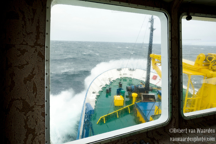 The bow of the Arctic expedition ship, Akademik Shokakskiy breaks through the waves off Greenland's West coast.