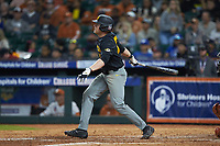 Luke Mann (16) of the Missouri Tigers follows through on his swing against the Texas Longhorns in game eight of the 2020 Shriners Hospitals for Children College Classic at Minute Maid Park on March 1, 2020 in Houston, Texas. The Tigers defeated the Longhorns 9-8. (Brian Westerholt/Four Seam Images)