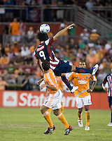 CD Guadalajara forward Omar Arellano (9) gets the header over Houston Dynamo defender Patrick Ianni (4).  CD Guadalajara defeated Houston Dynamo 1-0 during the group stage of the Superliga 2008 tournament at Robertson Stadium in Houston, TX on July 15, 2008.
