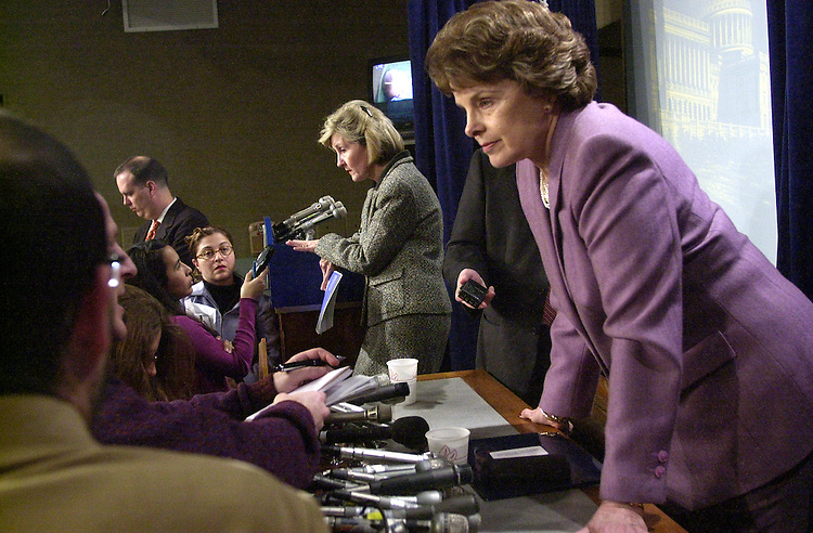 stabhutch1/011503 - Sen. Debbie Stabenow, D-Mi. (R), and Sen. Kay Bailey Hutchison, R-Tx., field questions from reporters about affirmative action after a press conference on Air Cargo safety.