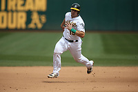OAKLAND, CA - APRIL 4:  Josh Phegley #19 of the Oakland Athletics runs the bases against the Boston Red Sox during the game at the Oakland Coliseum on Thursday, April 4, 2019 in Oakland, California. (Photo by Brad Mangin)