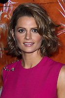 """HOLLYWOOD, CA - OCTOBER 01: Actress Stana Katic arrives at the screening of Xlrator Media's """"CBGB"""" held at ArcLight Cinemas on October 1, 2013 in Hollywood, California. (Photo by Xavier Collin/Celebrity Monitor)"""